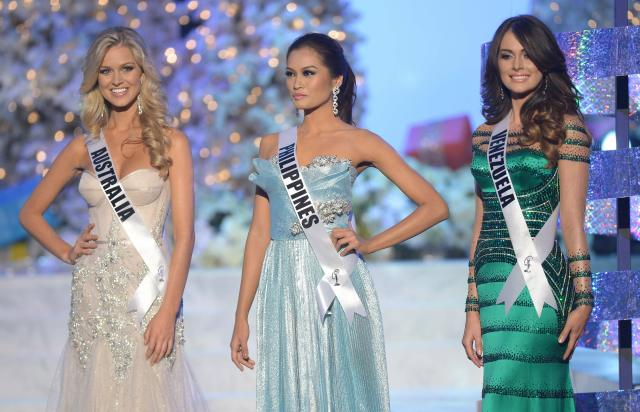 Miss Australia,  Renae Ayris (L); Miss Philippines, Janine Tugonon (C); and Miss Venezuela, Irene Sofia Esser Quintero (R) stand  on stage during the 2012 Miss Universe Pageant at Planet Holywood in Las Vegas, Nevada on December 19, 2012.  Eighty-nine countries and territories are participating in this year's pageant.   AFP PHOTO / JOE KLAMAR